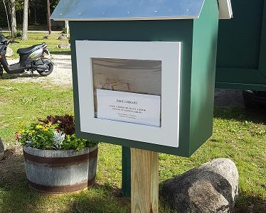 Take a selfie with one of our Little Libraries